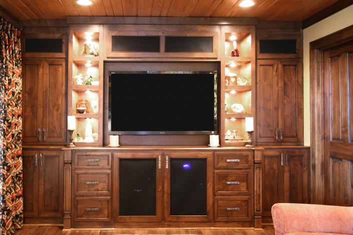media center, TV storage, custom cabinets, open shelves, movie room