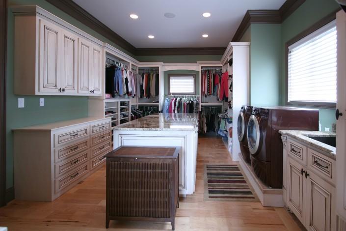 laundry room,custom closet,washer and dryer,folding area