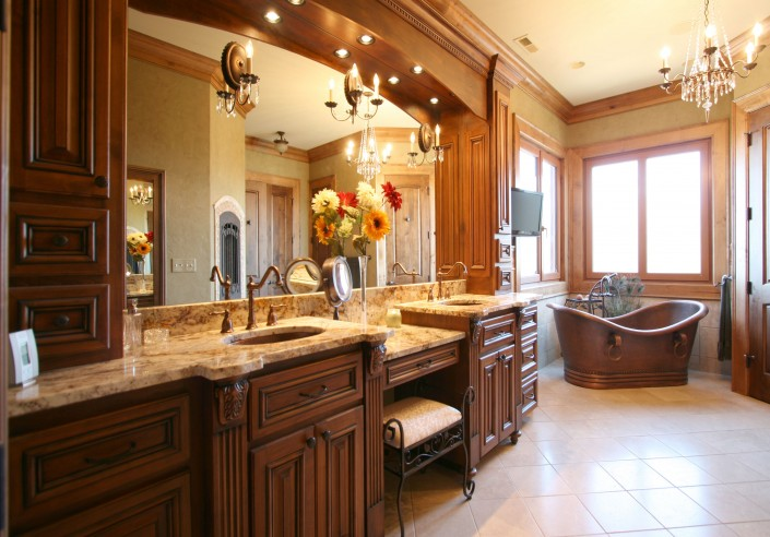 large bathroom ideas, his and hers, copper tub, vanity, stained cabinets,