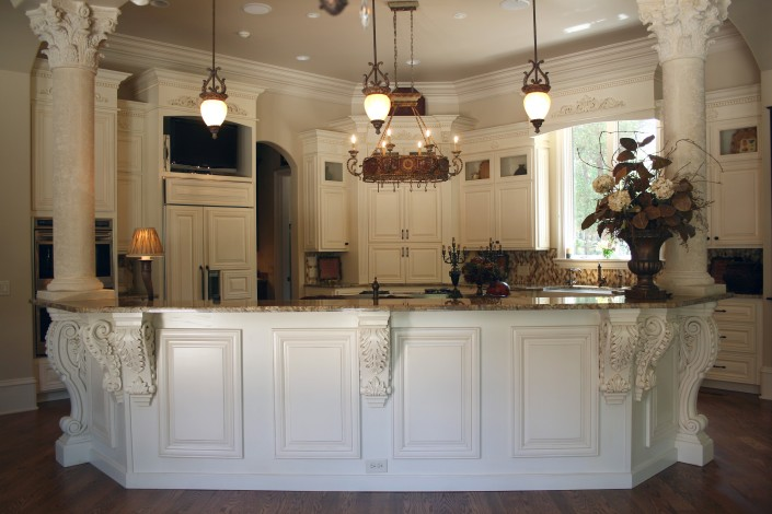 custom kitchen cabinets,white kitchen, kitchen design ideas, elegant kitchens, crown molding, applied molding, corbels, hidden appliances,