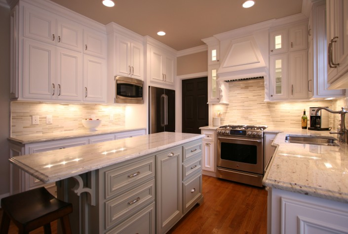 custom kitchen cabinets,transitional style, gray island, white cabinets, stainless appliances, cup pulls, hardwood floors