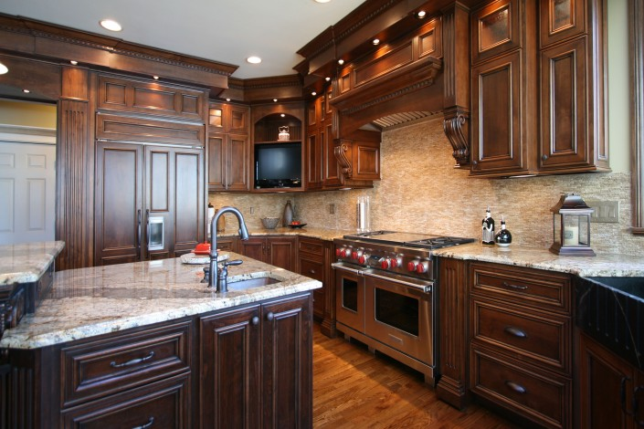 custom kitchen cabinets,kitchen remodel, custom cabinets, mantle hood, gas range, dark stained cabinets,